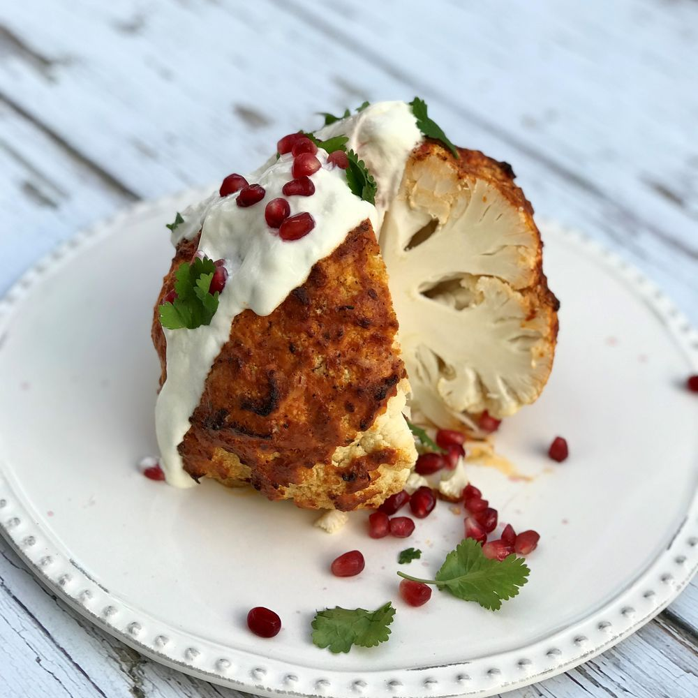 Whole Harissa Roasted Cauliflower with Pomegranate